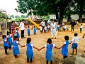 A group of school children forming a circle.jpg