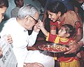 A little girl puts Tilak to the forehead of the Vice president Shri Bhairon Singh Shekhawat on the auspicious occasion of 'Raksha Bandhan' in New Delhi on August 30, 2004.jpg