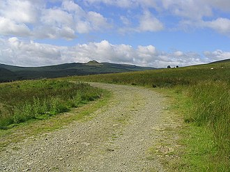 Hawick - A track to the west of Shankend Farm, the twin summits in the distance are the Maiden Paps.