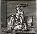 A young Jewish woman with long-crowned turban kneels on a Wellcome V0019180.jpg