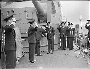 Boatswain's call - King George VI is piped aboard a Royal Navy battleship in 1942