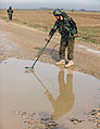 Afghan National Army Soldier Khan Ali uses a metal detector (4329489259).jpg