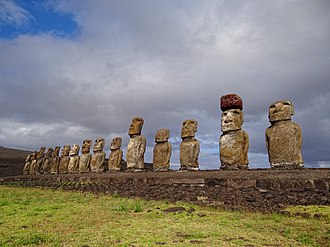 Ahu Tongariki - Ahu Tongariki. The second moai from the right has a pukao on its head.