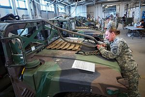 United States Army Pathfinder School - A pathfinder student inspect the readiness of a U.S. Army HMMWV for sling load operations