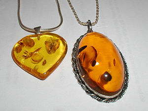 Amber pendants made of modified amber. The ova...
