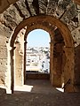 Amphitheatre of El Jem - arch closeup.jpg
