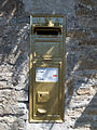 Ampney St Peter gold post box.jpg