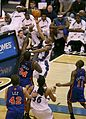 Antonio Daniels shoots over Eddy Curry.jpg
