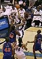 Antonio Daniels shoots over Eddy Curry.jpg