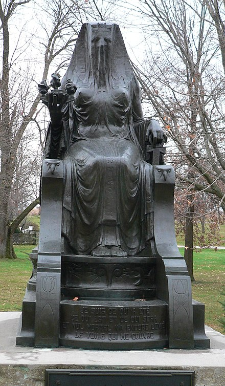 Statue of a woman on a throne covered by a veil