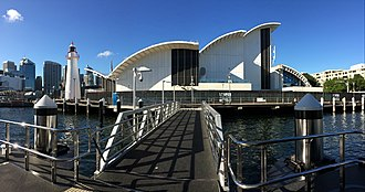 Australian National Maritime Museum - View of the Museum and Cape Bowling Green Lighthouse from Pyrmont bay wharf.