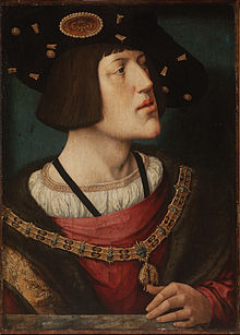 Portrait by Bernard van Orley, 1519. The insignia of the Order of the Golden Fleece are prominently displayed. (Source: Wikimedia)