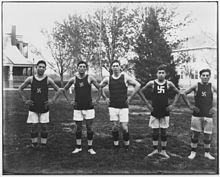 five young men in basketball uniforms with swastika logo