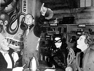 Supervillain - Supervillains from the 1966 film Batman, a film adaptation of the comic books based on Batman and the 1960s television show of the same name. From left to right: Penguin, Riddler, Catwoman, and Joker.