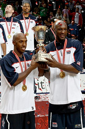 Lamar Odom - Chauncey Billups (left) and Odom holding 2010 FIBA World Championship trophy.