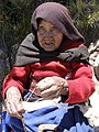 Blind woman spinning wool by hand Peru.jpg