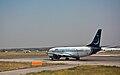 Blu-express Boeing 737-300 EI-DXC Fiumicino Airport.jpg