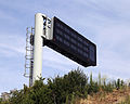 Boundary of Theydon Bois wood Essex England ~ M11 variable road sign.JPG