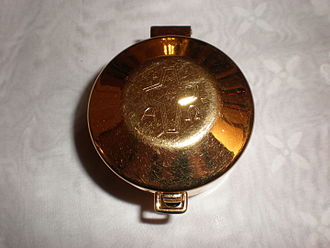 Pyx - A bronze pyx for carrying the consecrated Host.