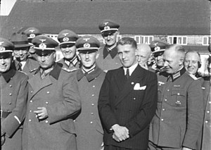 Wernher von Braun - First rank, from left to right, General Dr Walter Dornberger (partially hidden), General Friedrich Olbricht (with Knight's Cross), Major Heinz Brandt, and Wernher von Braun (in civil garment) at Peenemünde, in March 1941.