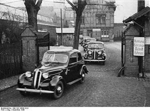 """BMW 321 - In 1948 the first batch of postwar BMW 321s allocated for """"civilian use"""" was photographed leaving the Eisenach plant. The batch was of just fifteen cars."""