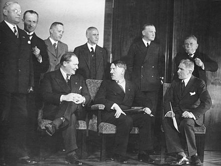 The first meeting of Hitler's cabinet in 1933, with Krosigk standing third from left. Bundesarchiv Bild 183-H28422, Reichskabinett Adolf Hitler.jpg