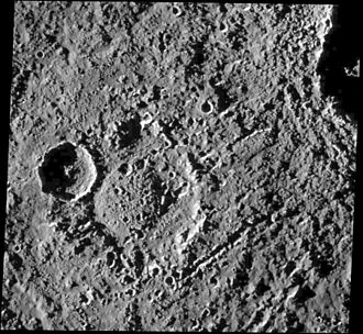 Callisto (moon) - Impact crater Hár with a central dome. Chains of secondary craters from formation of the more recent crater Tindr at upper right crosscut the terrain.