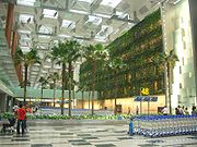 Baggage collection point; the Green Wall (right) spans 300m (980ft) and comprises 25 species of climbing plants.
