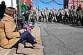 Citizens of Goldsboro, N.C., watch as U.S. Airmen stationed at Seymour Johnson Air Force Base march in a Veterans Day parade in the city Nov. 11, 2013 131111-F-YG094-275.jpg