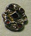 Cividale, man, fibula a S in argento dorato, da necropoli cella 14 con granati almandini.jpg