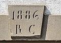 Clé de linteau datée de 1886 à Urcerey.jpg