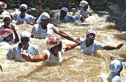Vodouists washing in a river following a ceremony; photographed in Haiti in 2010 Cleaning their sins.jpg