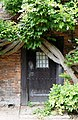 Climber over east door of Fore Street Lodge Hatfield House Hertfordshire England.jpg