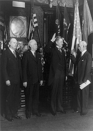 Patrick J. Hurley - Hurley (second from right) being sworn in as Assistant War Secretary by John B. Randolph. Outgoing Assistant Secretary Charles B. Robbins and Secretary of War James W. Good look on.