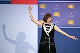 Comedian Kristen Schaal performs during the comedy show in celebration of the 75th anniversary of the USO and the 5th anniversary of Joining Forces (26240108933).jpg