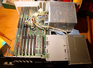 Amiga 2000 - Inside of the Amiga 2000 (hardware revision 6.2). The third and fourth slots from the left are bridge slots, with Zorro II connectors inline with ISA connectors.