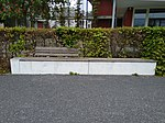 Concrete bench with wooden seat, Chaponnièrepark, Bern.jpg