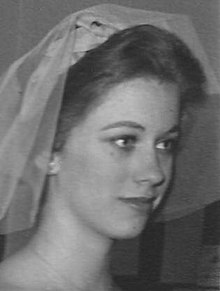 A black and white image of Booth with what appears to be a veil on her head.