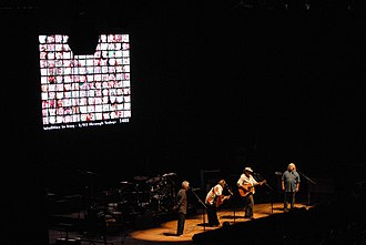 "Crosby, Stills, Nash & Young - 2006 ""Freedom of Speech"" tour. One of the backdrops, as shown here, were the photos of American soldiers who had died in the war in Iraq."