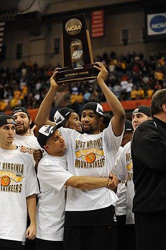 Da'Sean Butler - De'Sean Butler of West Virginia University lifts the East Region trophy after defeating Kentucky 73–66 in the 2010 NCAA Men's Basketball Tournament.