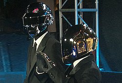 Thomas and GuyManuel de Homem wearing their signature robot style helmets in public