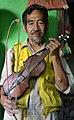 Dalimus Arip with his rabab pasisie.jpg