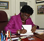 Dame Pearlette Louisy at her desk at Government House in Castries, St. Lucia.jpg