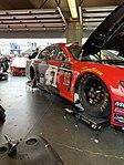Daniel's cars in the garage area at Daytona.jpg