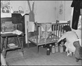 Daughter of Archie Isreal, miner. Two adults and five children live in this three room house which rents for $5.25... - NARA - 541123.tif