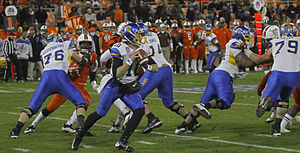2012 Military Bowl - San Jose State's David Fales drops back to pass.