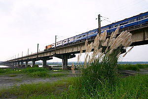 Rail transport in Taiwan - TRA train passing over the Kaoping Bridge in Kaohsiung