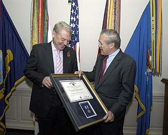 Paddy Ashdown - Ashdown receiving the Distinguished Public Service Award from US Secretary of Defense Donald Rumsfeld in November 2004