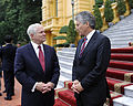 Defense.gov News Photo 101012-F-6655M-019 - Secretary of Defense Robert M. Gates right chats with Australian Defense Minister Stephen Smith during the first Association of Southeast Asian.jpg