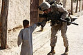 Defense.gov News Photo 101101-M-6340O-093 - U.S. Marine Corps Lance Cpl. Steven J. Zandstra with Police Adviser Team 1 3rd Battalion 5th Marine Regiment Regimental Combat Team 2 shakes.jpg